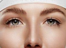 Occhi della donna del primo piano Fotografia Stock
