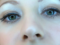 Occhi delle ragazze del primo piano Fotografie Stock