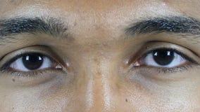 Occhi di lampeggiamento dell'uomo Immagini Stock