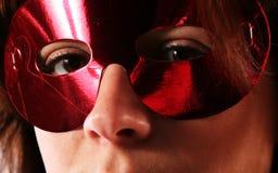 Occhi dietro la mascherina Fotografia Stock Libera da Diritti
