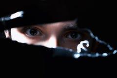 Occhi spaventosi di un uomo Immagini Stock