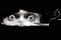 Occhi spaventosi di un uomo Immagine Stock