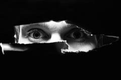 Occhi spaventosi di un uomo Fotografia Stock