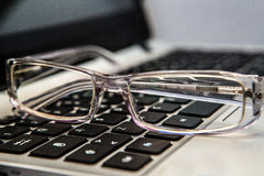 occhiali con la tastiera Immagini Stock