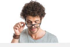 Occhiali d'uso del giovane Fotografie Stock