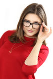 Occhiali d'uso di modello delle giovani donne graziose Fotografia Stock