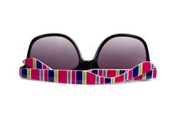 Occhiali da sole con le strisce multi-colored Fotografie Stock Libere da Diritti