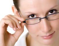 Occhiali della donna di affari Fotografia Stock