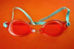 Occhiali di protezione arancio di nuoto Fotografia Stock