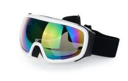 Occhiali di protezione dello sci isolati sui precedenti bianchi fotografia stock