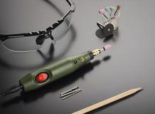 Occhiali di protezione e strumento rotatorio Fotografie Stock Libere da Diritti