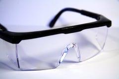 Occhiali di protezione su bianco Fotografia Stock Libera da Diritti