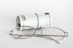 Occhiali e soldi Fotografie Stock Libere da Diritti