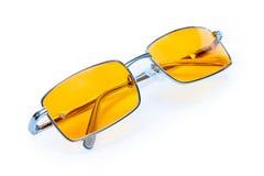 Occhiali gialli di vetro di notte fotografia stock