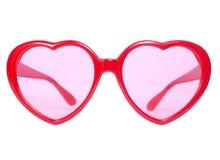 Occhiali rossi del cuore fotografia stock
