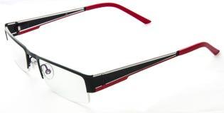 Occhiali rossi neri sulla parte superiore bianca del fondo Fotografie Stock Libere da Diritti