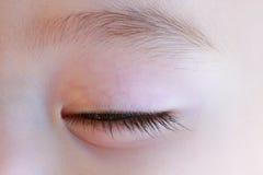 Occhio chiuso del bambino addormentato Fotografie Stock Libere da Diritti