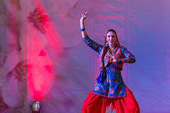 Occidental woman dances holy Indian dance. An Occidental woman dances Indian style on a stage during Festival d'Oriente  (Festival of Orient). The event  took Royalty Free Stock Images