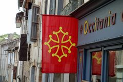 Occitania flag on a street shop.  royalty free stock image