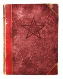 Occult book. With pentagram and free copy space, isolated against white background royalty free stock photo