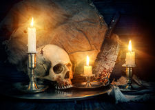 Occult composition. With an old skull and candles stock photo