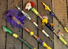 Close up with decorated magic wands on wooden planks, top view Royalty Free Stock Images