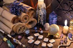 Ancient paper scrolls with runes and magic crystals. Occult, esoteric, divination and wicca concept. Mystic and vintage background with old objects Stock Photography