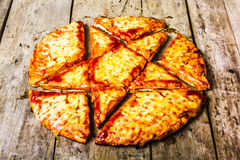 Occult offering. Evil food photography on a horror pentagram etched into a pizza of occult offering Stock Photo