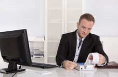 Occupation controller: young businessman looking frustrated at p Stock Images