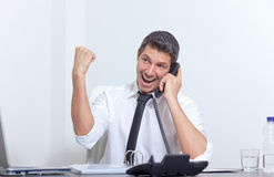 Occupational advancement. Arm rising happy male chief manager phoning while getting professional career advancement Royalty Free Stock Images