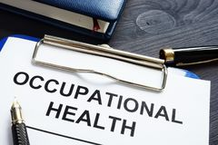 Occupational health report and notepad. Occupational health report, pen and notepad stock images