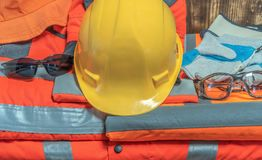 Occupational safety equipment in companies. Occupational safety equipment suit gloves gloves vest of helmet stock photography