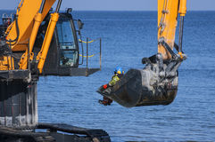 OCCUPATIONAL SAFETY - EXCAVATOR IN WATER Royalty Free Stock Photo