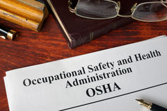Occupational Safety and Health Administration OSHA. And a book royalty free stock photos