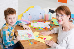 Occupational therapist and kid with adhd Stock Image