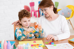 Occupational therapist and little boy Stock Photo