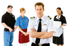 Occupations: Airline Pilot Leads Serious Group. Extensive series featuring a multi-ethnic group of people in various occupations.  Includes policeman Stock Photo
