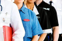 Occupations: Anonymous Group of People in Various Jobs. Extensive series featuring a multi-ethnic group of people in various occupations.  Includes policeman Stock Photos