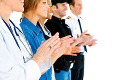 Occupations: Anonymous People Applauding. Extensive series featuring a multi-ethnic group of people in various occupations.  Includes policeman, housekeeper Stock Image