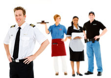 Occupations: Cheerful Pilot Stands With Group of Employees Royalty Free Stock Images