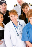 Occupations: Doctor in Center of Group of Occupations Royalty Free Stock Image