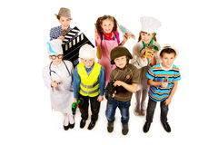 Occupations. A group of children dressed in costumes of different professions. Isolated over white Royalty Free Stock Photo