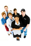 Occupations: Housekeeper Leads Group of Employees. Extensive series featuring a multi-ethnic group of people in various occupations.  Includes policeman Royalty Free Stock Photography