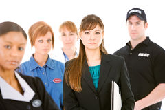Occupations: Serious Businesswoman Leads Group. Extensive series featuring a multi-ethnic group of people in various occupations.  Includes policeman Stock Photo
