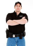 Occupations: Serious Police Officer. Extensive series featuring a multi-ethnic group of people in various occupations.  Includes policeman, housekeeper, doctor Royalty Free Stock Photos