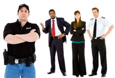 Occupations: Serious Policeman with Others Behind. Extensive series featuring a multi-ethnic group of people in various occupations.  Includes policeman Stock Photos