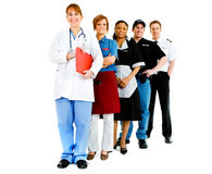 Occupations: Variety of Jobs in a Line. Extensive series featuring a multi-ethnic group of people in various occupations.  Includes policeman, housekeeper Royalty Free Stock Image