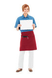 Occupations: Waitress Holds Up Blank Sign. Extensive series featuring a multi-ethnic group of people in various occupations.  Includes policeman, housekeeper Stock Images