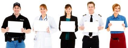 Occupazioni: Gli impiegati tutti ostacolano i segni in bianco Fotografia Stock