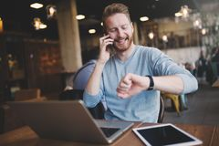 Occupied businessman multitasking in cafe stock images